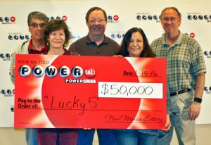 Gladys Gonzales, Alexander Kenny, Michael Wilcox and Elizabeth Wagner of Albuquerque and Steven Peddy, winners of $50,000 Powerball prize